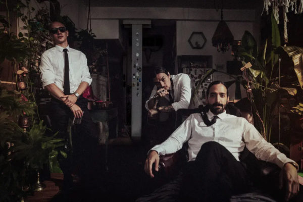 MakeWar Band promo photo dressed in suits